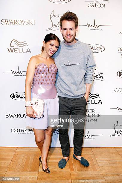 German actress Anna Angelina Wolfers and her boyfriend Johannes Strate singer of the band Revolverheld attend the Marina Hoermanseder defilee during...
