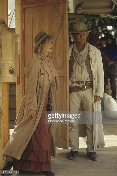 German actress Anne Kasprik coming out of a door beside Italian actor and director Terence Hill in the film Troublemakers Santa Fe 1994
