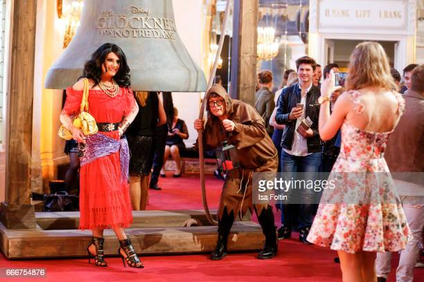 German actress AnneCatrin Maerzke makes a cellphone picture of Rolf Scheider in the mask of Quasimod and a guest in the mask of Esmeralda during the...