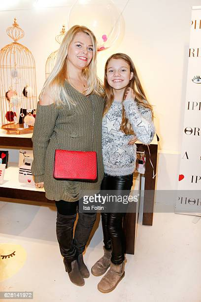 German actress AnneSophie Briest and her daughter youtube star Faye Montana attend the Iphoria store opening on December 6 2016 in Berlin Germany