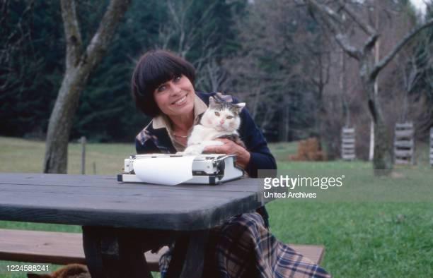 "German actress Barbara Ruetting with her cat ""Fettucini"", Germany, 1970s."