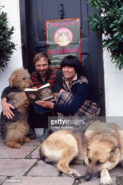 German actress Barbara Ruetting with Lutz Hochstraate and her dogs, Germany, 1970s.