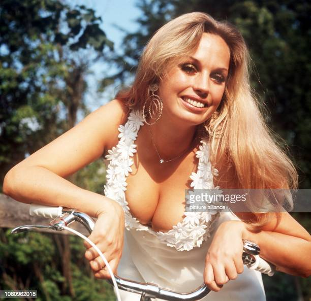 German actress Barbara Valentin shows a deep cleavage in her white summer dress on the 27th of August in 1970 in Munich