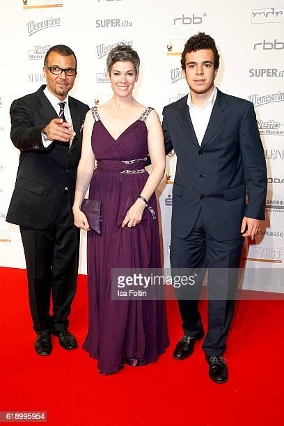 German actress Cheryl Shepard and her husband Nikolaus Okonkwo and her son Chenoa Okonkwo attend the Goldene Henne on October 28 2016 in Leipzig...