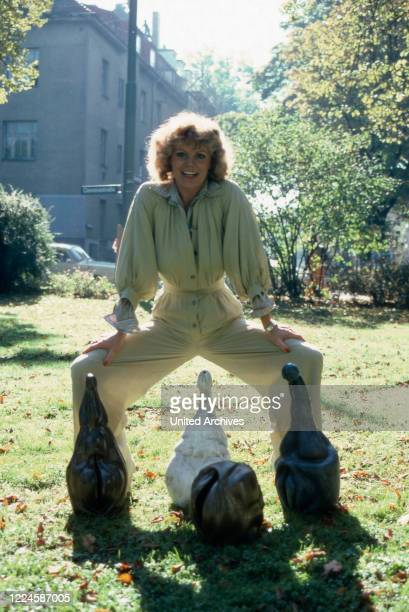 German actress Christiane Ruecker in the garden with penis and vagina sculptures Germany 1970s