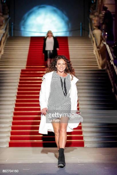 German actress Christine Neubauer walks the runway during the Minx Fashion Night in favour of 'Sauti Kuu' of Auma Obama at Wuerzburger Residenz on...