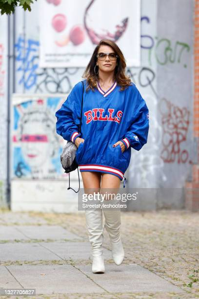 German actress Christine Neubauer wearing a 90s vintage dark blue Buffalo Bills football longsleeve shirt with red and white stripes, white knee high...