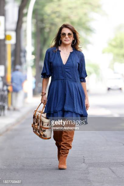 German actress Christine Neubauer wearing a dark blue midi length dress with v-neck and lace and mesh details by Alice and Olivia, vintage brown knee...