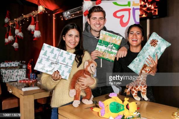 German actress Chryssanthi Kavazi German presenter Christian Wackert and German presenter Steffi Brungs wrap presents for children in need during the...