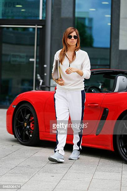 German actress Claudia Eisinger in front of a Porsche 718 Boxster S wearing a total look and the MetricClutch from Porsche Design Women SS17...