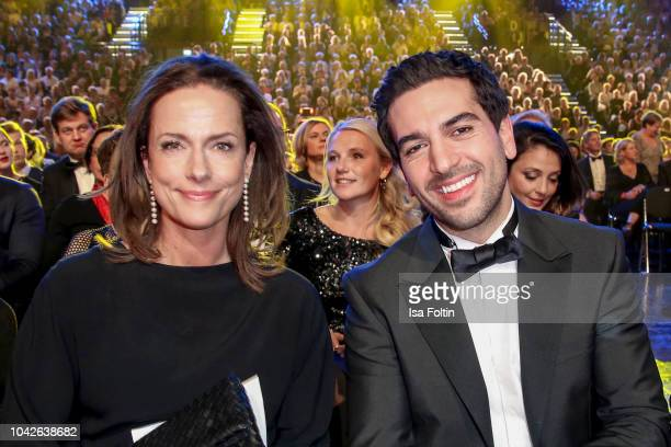 German actress Claudia Michelsen and German actor Elyas MBarek during the Goldene Henne on September 28 2018 in Leipzig Germany