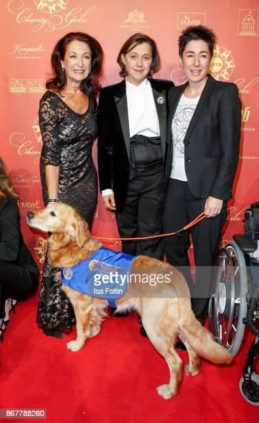 German actress Daniela Ziegler Vita founder Tatjana Kreidler German presenter Dunja Hayali and an assistance dog during the 8th VITA Charity Gala on...