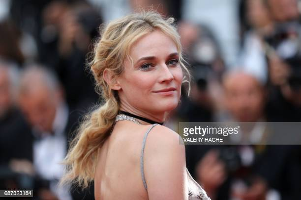 TOPSHOT German actress Diane Kruger poses as she arrives on May 23 2017 for the '70th Anniversary' ceremony of the Cannes Film Festival in Cannes...