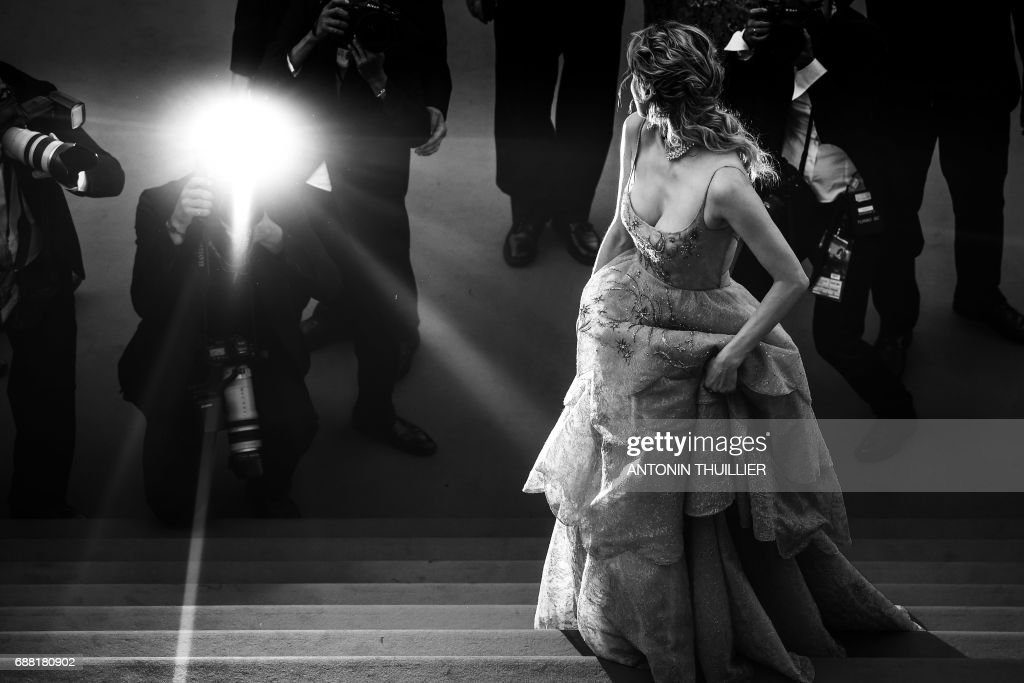 German actress Diane Kruger poses as she arrives on May 23, 2017 for the '70th Anniversary' ceremony of the Cannes Film Festival in Cannes, southern France. / AFP PHOTO / Antonin THUILLIER