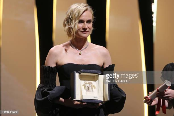 TOPSHOT German actress Diane Kruger poses on stage after she was awarded with the Best Actress Prize for her part in 'Aus dem Nichts' on May 28 2017...