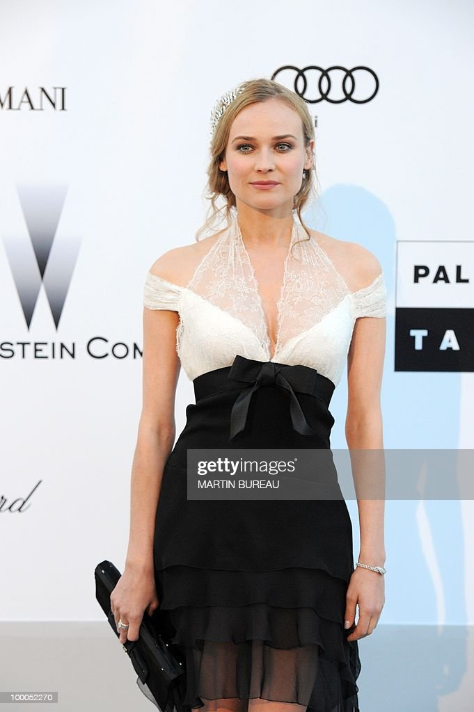 German actress Diane Kruger poses while arriving to attend the 2010 amfAR's Cinema Against Aids on May 20, 2010 in Antibes, southeastern France.