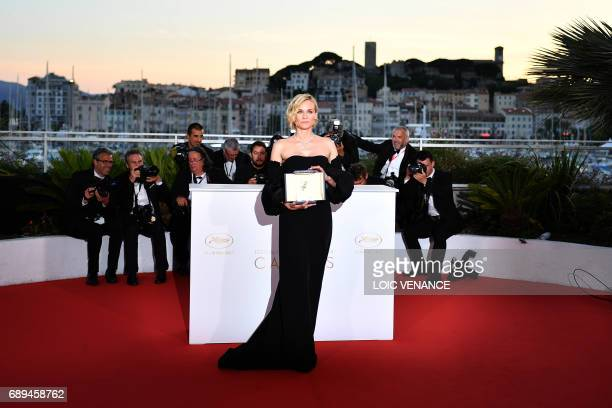 German actress Diane Kruger poses with her trophy during a photocall on May 28 2017 after she won the Best Actress Prize for her part in the film 'In...