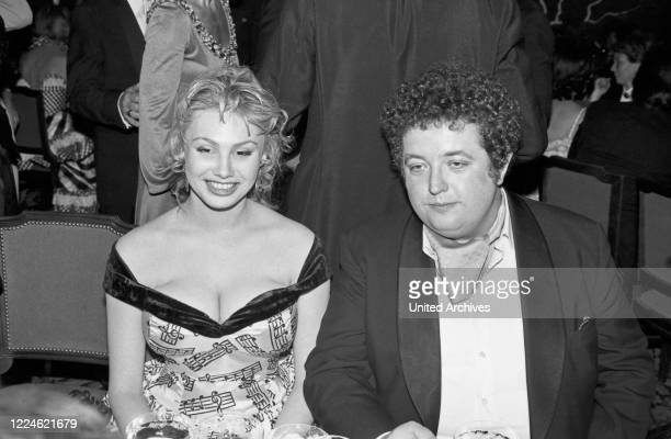 German actress Dolly Dollar and actor Peter Kern at the Deutscher Filmball on January 11th 1981 at Munich, Germany, 1980s.