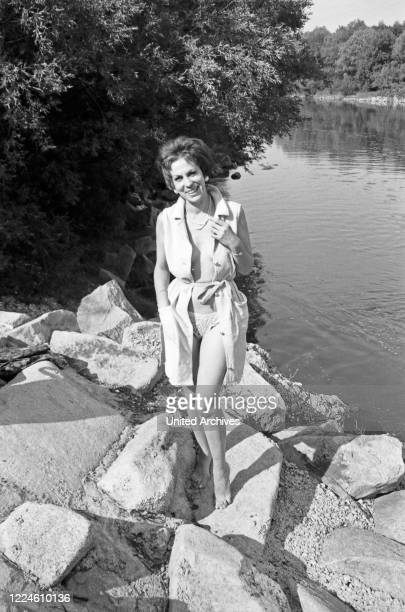 German actress Elfi Helfrich at river Isar in Munich, Germany, 1960s.
