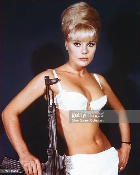 German actress Elke Sommer as assassin Irma Eckman, wielding a submachine gun in a publicity still for the film 'Deadlier Than the Male', 1967.