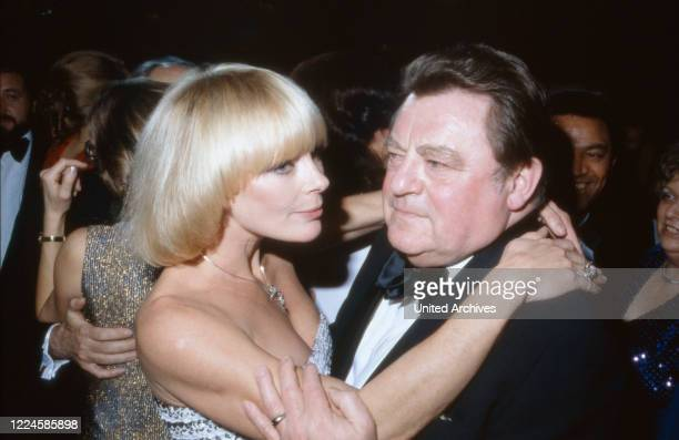 German actress Elke Sommer dancing with CSU Politician and Bavarian Prime Minister Franz Josef Straufl, Germany, 1980s.