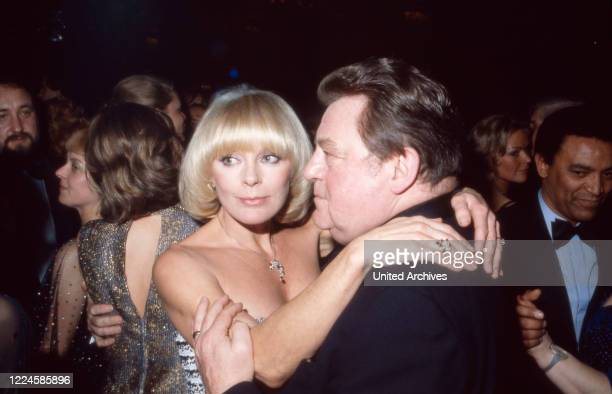 German actress Elke Sommer dancing with Franz Josef Straufl, Germany, 1980s.