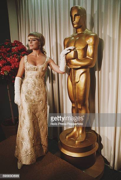German actress Elke Sommer pictured standing next to a life size version of an Oscar statuette at the 40th Academy Awards at the Santa Monica Civic...