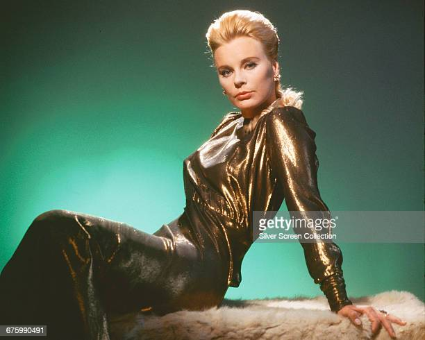 German actress Elke Sommer poses in a gold lamé evening dress circa 1970