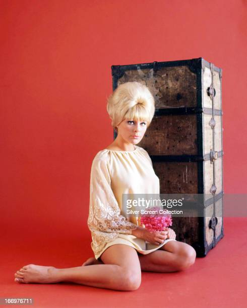 German actress Elke Sommer sitting by a packing trunk circa 1965