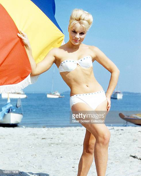 German actress Elke Sommer wearing a bikini on a beach circa 1963