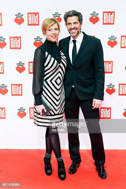 German actress Franziska Weisz and Pasquale Aleardi attend the Ein Herz Fuer Kinder gala on December 3 2016 in Berlin Germany