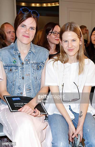 German actress Fritzi Haberlandt and Aino Laberenz attend the Malaikaraiss defilee during the Der Berliner Mode Salon Spring/Summer 2017 at...