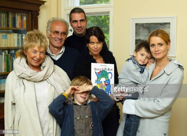 "German actress Gerit Kling poses with her new children's book ""Unser Grosses Haus"" and family members mother Margarita Kling, her father Ulrich..."