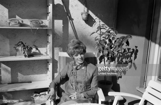 German actress Grit Boettcher in the living room Germany 1960s
