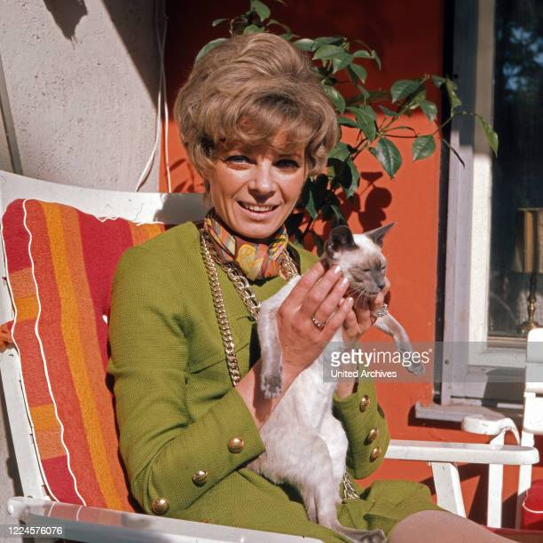 German actress Grit Boettcher with a cat Germany 1960s