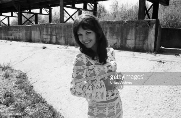 German actress Inge Marschall doing a photo shoot, Germany, 1960s.