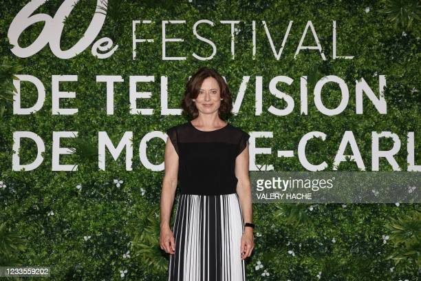 """German actress Inka Friedrich poses during a photocall for the TV show """"The Unbearable Lightness of the Revolution"""" as part of the 60th Monte-carlo..."""