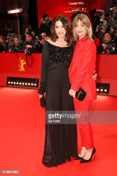 German actress Iris Berben and German actress Heike Makatsch attend the Opening Ceremony & 'Isle of Dogs' premiere during the 68th Berlinale...