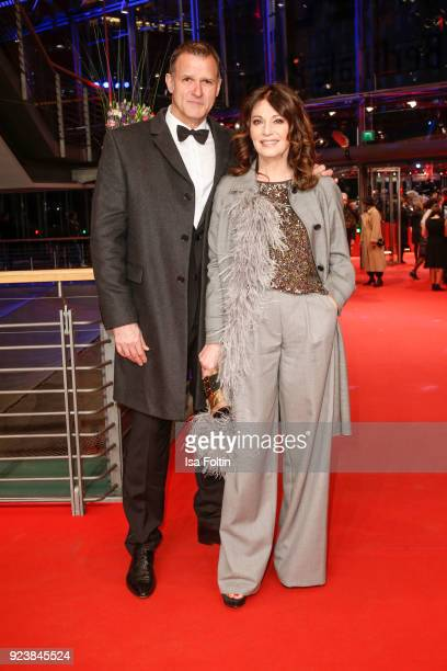 German actress Iris Berben and her partner Heiko Kiesow attend the closing ceremony during the 68th Berlinale International Film Festival Berlin at...