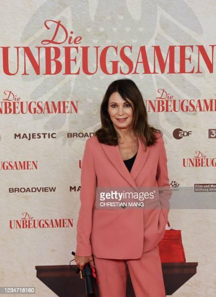 "German actress Iris Berben poses ahead of the premiere of the documentary movie ""Die Unbeugsamen"" by German film director Torsten Koernerat at Delphi..."