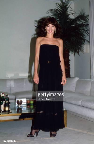 German actress Iris Berben wearing an evening robe, Germany, 1970s.