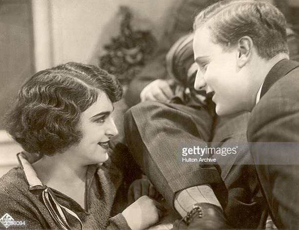 German actress Jenny Jugo exchanges a tender look in a scene from the German UFA silent film 'Die Gefundene Braut'