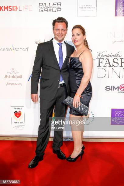 German actress Julia Dahmen and her husband Carlo Fiorito attend the Kempinski Fashion Dinner on May 23 2017 in Munich Germany