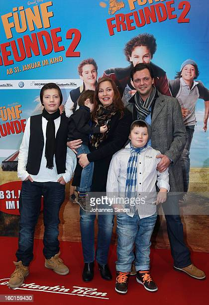 German actress Julia Dahmen her husband Carlo Fiorito and family arrive for the 'Fuenf Freunde 2' movie premiere at CineMaxx Cinema on January 27...