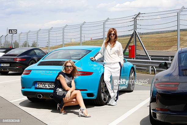 German actress Julia Dietze and german actress Claudia Eisinger in front of a Porsche 911 Carrera S both wearing a total look from the Porsche Design...