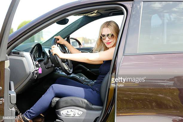 German actress Julia Dietze wearing a total look from Porsche Design Woman SS17 Collection and drives a Porsche Cayenne S during the Offroad Tour at...