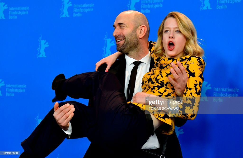 German actress Julia Zange and Swiss actor Urs Jucker pose during a photo call for the film 'My Brother's Name is Robert and He is an Idiot' (Mein Bruder heisst Robert und ist ein idiot) presented in competition during the 68th edition of the Berlinale film festival in Berlin on February 21, 2018. / AFP PHOTO / Tobias SCHWARZ