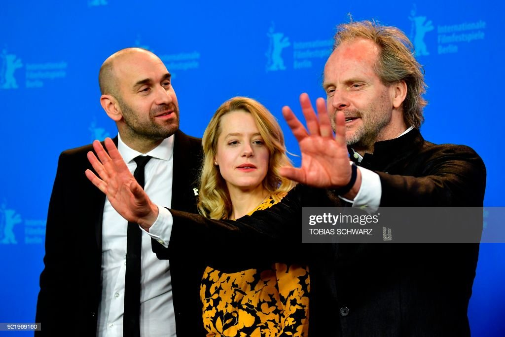 German actress Julia Zange (C), German director Philip Groening (R) and Swiss actor Urs Jucker pose during a photo call for the film 'My Brother's Name is Robert and He is an Idiot' (Mein Bruder heisst Robert und ist ein idiot) presented in competition during the 68th edition of the Berlinale film festival in Berlin on February 21, 2018. / AFP PHOTO / Tobias SCHWARZ