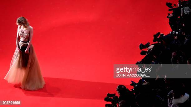 TOPSHOT German actress Julia Zange poses on the red carpet before the awards ceremony of the 68th edition of the Berlinale film festival on February...