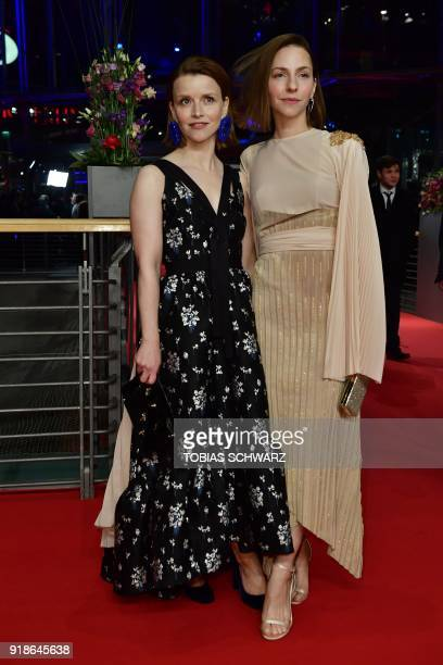 German actress Katharina Schuettler and German actress Karoline Schuch pose on the red carpet upon their arrival at the Berlinale Palace for the...